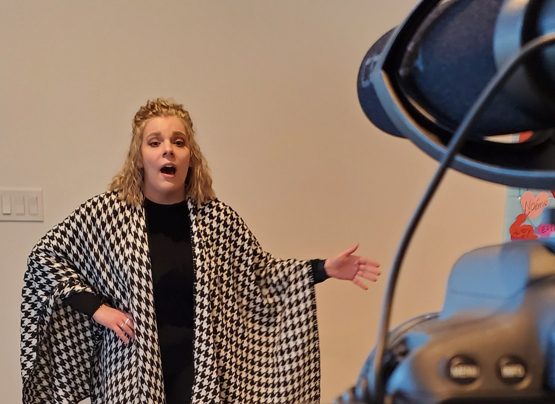 """""""Cloe Afton Papworth performs before a video camera to record her vocal entry for the First Virtual Shuswap Music Festival held in April 2021."""" Photo Credit: C. Papworth"""